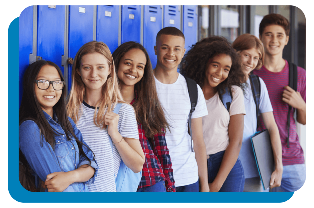 A group of students standing in front of lockers